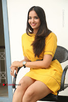 Actress Poojitha Stills in Yellow Short Dress at Darshakudu Movie Teaser Launch .COM 0242.JPG