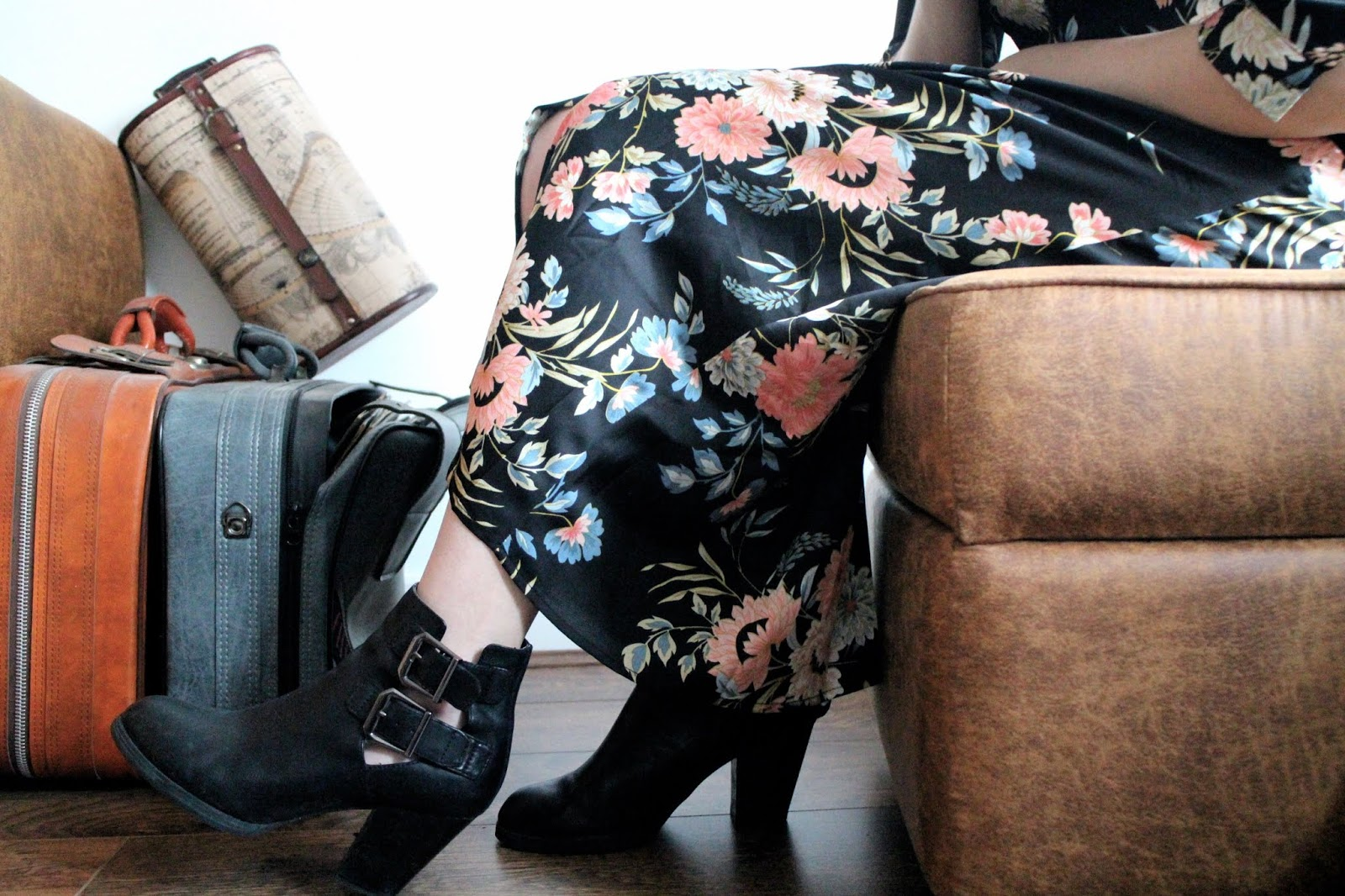 Crop of floral dress and close up of black boots with buckles