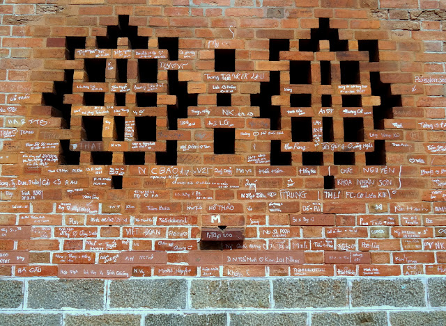 Side Brick Wall Notre Dame Cathedral in Ho Chi Minh City - Saigon, Vietnam