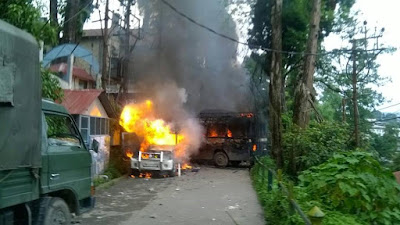 Police vehicles torch by GJM supporter