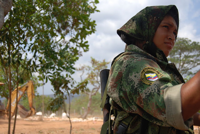 FARC guerrilla, Solange Mendoza, on guard duty at the FARC's Tierra Grata demobilization zone in northern Colombia, in the province of Cesar, near the town of San Jose de Oriente. February 15, 2017. Photo: Anastasia Moloney