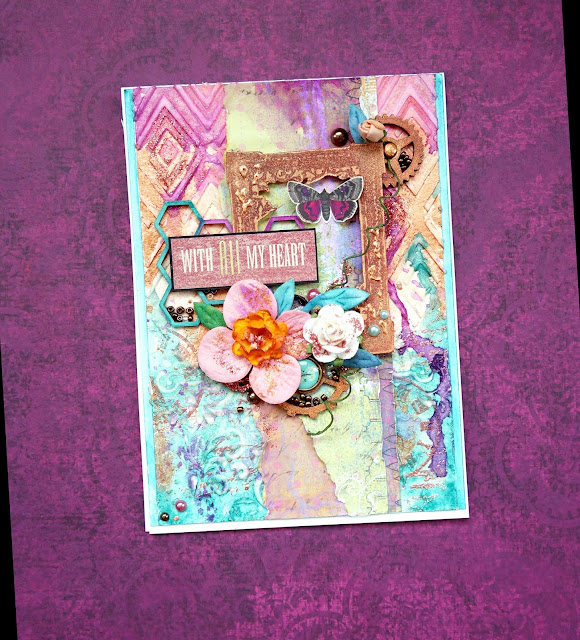 A mixed media card with flowers and gears