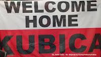 Robert Kubica flaga Welcome home F1