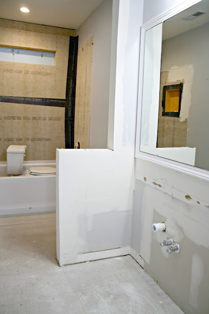 Taking down separating wall in bathroom