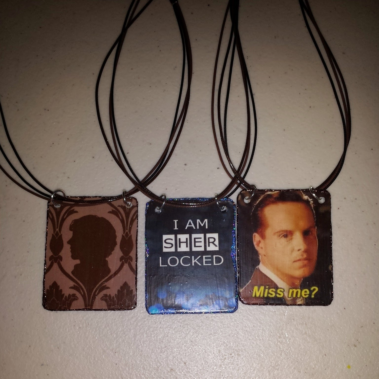 Finished upcycled gift card pendants for BBC Sherlock