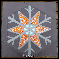 http://www.craftsy.com/pattern/quilting/other/snowflake-12-inch-paper-pieced/59189