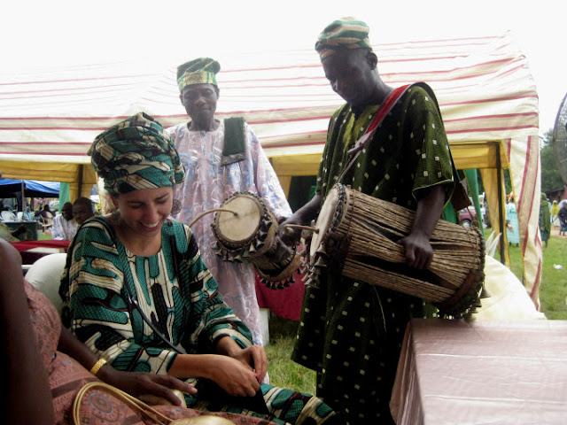 Drummers entertaining with the talking drum