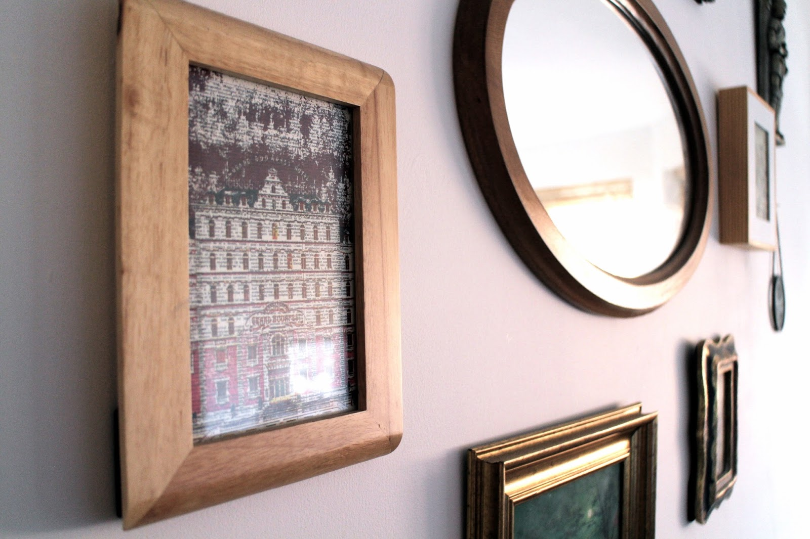 Multiple picture frames on a white wall