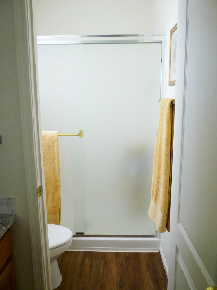 how to clean soap scum off frosted shower doors