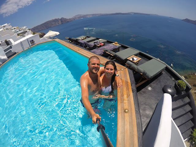 Couple in swimming pool at Nostos Apartments Oia Santorini