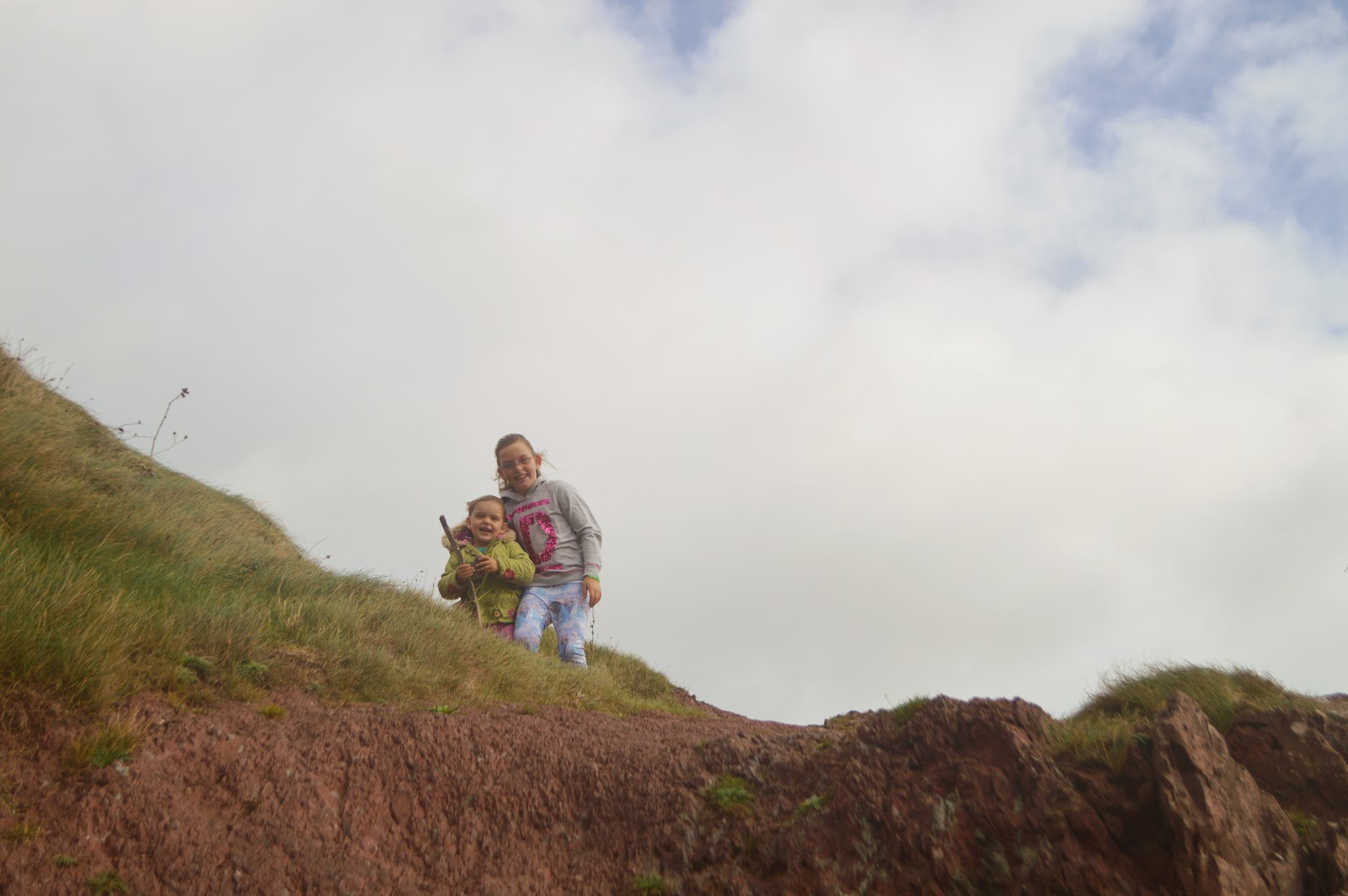 Girls on Top of Rocks at Manorbier Beach, Pembrokeshire, Wales