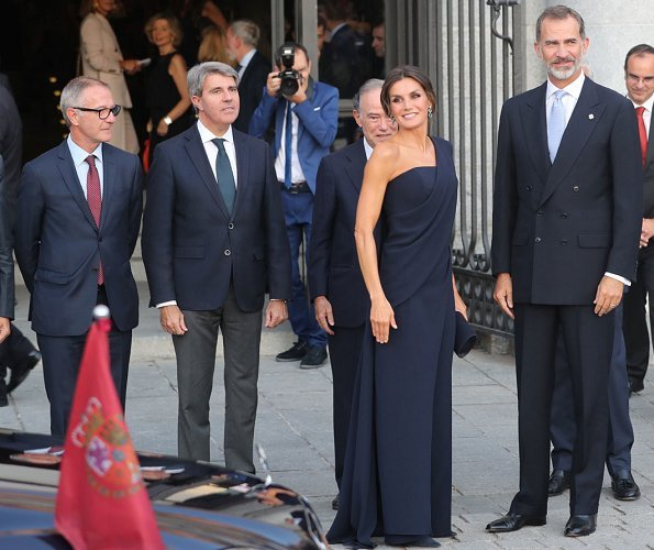 Queen Letizia wore Pedro del Hierro jumpsuit and Nina Ricci pumps, carried Felipe Varela clutch bag