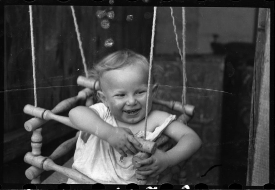 These 32 Pictures Had Been Buried For Years. The Reason Is Heart-Breaking - 1940-1944: A Boy In A Doorway Swing