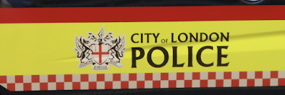 The City of London's coat of arms on the door of a City of London police vehicle