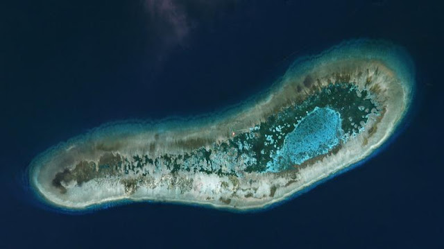 Vietnamese-held Ladd Reef, in the Spratly Island group in the South China Sea, July 19, 2016, in this Planet Labs handout photo received by Reuters on December 6, 2016. Trevor Hammond/Planet Labs/Handout via REUTERS