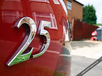 MG Rover 25 badge on Solar Red car