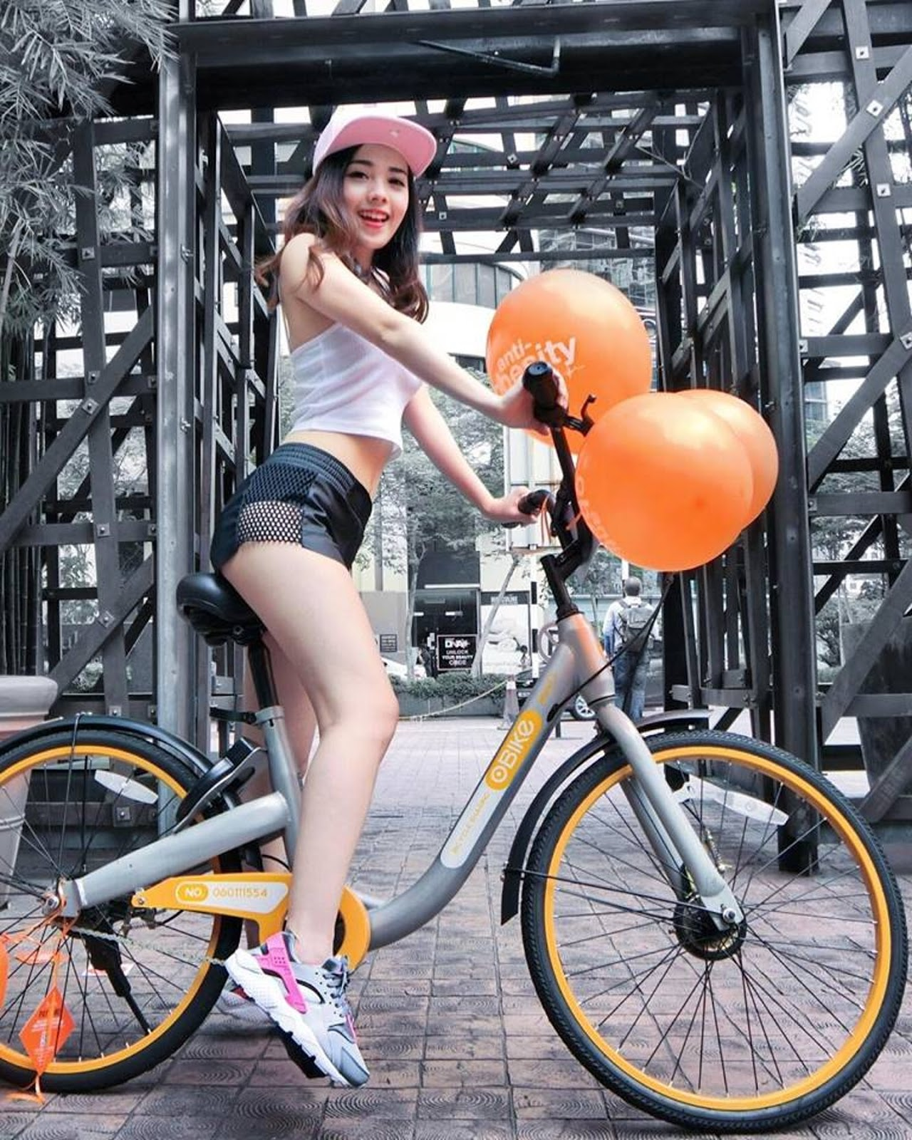 Mabel Goo, AirAsia Stewardess, cycling the once upon a time, a historic OBike