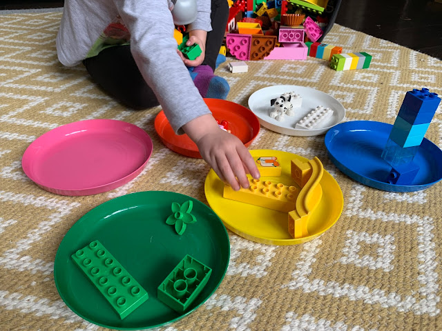Sorting LEGO DUPLO into matching coloured IKEA plates