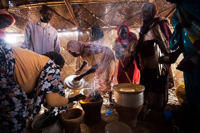 African cooking in Rwanda camp for internally displaced people