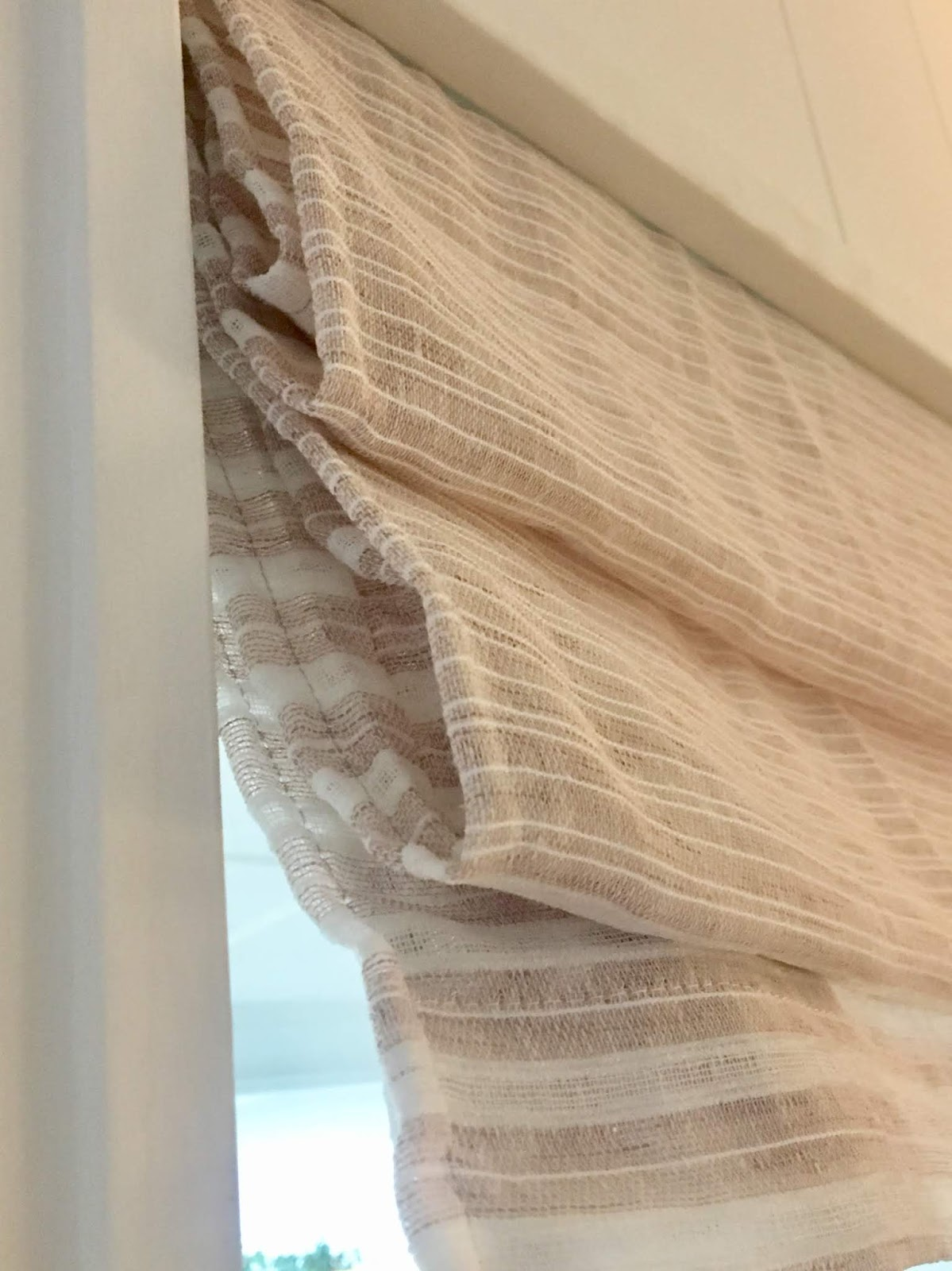 We needed a little color and texture on the windows in our living room. We didn't need the privacy so I didn't want to pay for actual shades. Instead I made two faux roman shades for under $40 and I love them!   House Homemade