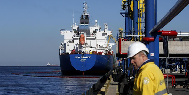 Image Attribute: A file photo of an oil tanker CPO France (IMO:  9347308/MMSI:  538008324) being loaded at the Ust-Luga oil products terminal/ Date: April 9, 2014,/ Source: Alexander Demianchuk, Reuters