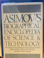 Asimov's Biographical Encyclopedia of Science and Technology, by Isaac Asiimov, superimposed on Intermediate Physics for Medicine and Biology.