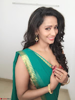 Sanjana Singh Looks Super cute in Green Saree Sleeveless Choli 5.JPG