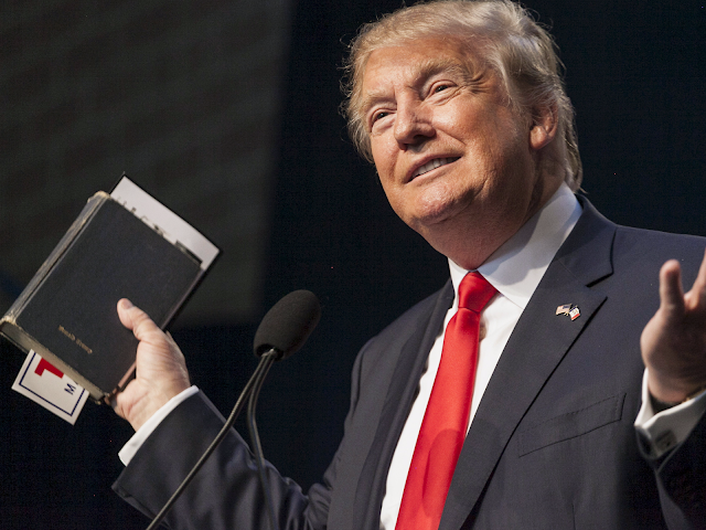Donald Trump holding a bible while speaking at a Faith and Freedom Coalition forum in Des Moines, Iowa (September 19, 2015) Photograph by Brian C. Frank