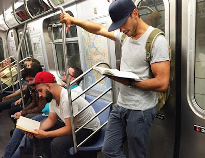 men reading novel in metro