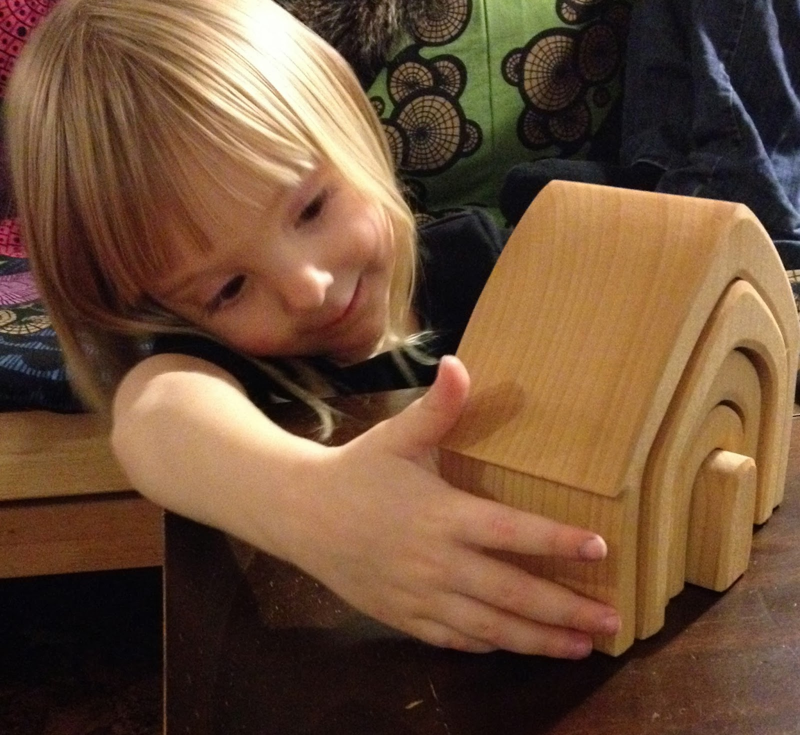 A Grimm's Wooden Doll House - an open ended toy.