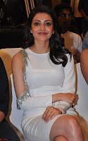 Beautiful Smiling Kajal Aggarwal in Creamy White Gown at MLA Telugu Movie Success Meet ~ .com Exclusive Pics 013.jpg