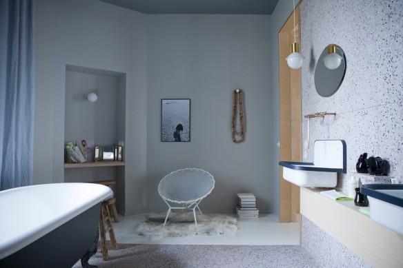 Graue Gemütlichkeit schärft die Sinne in Küche, Schlafzimmer und Bad - eine Einrichtung im Design eines fein gewebten Kokons