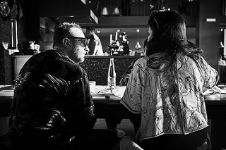 A Man Talking To A Woman At A Restaurant