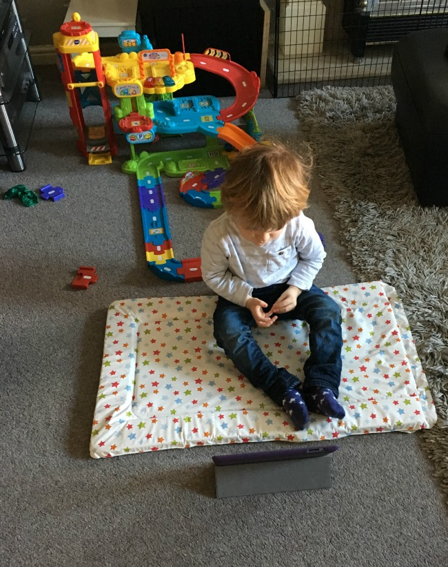 Our-weekly-journal-9th-Jan-2017-toddler-sat-on-changing-mat-looking-at-ipad