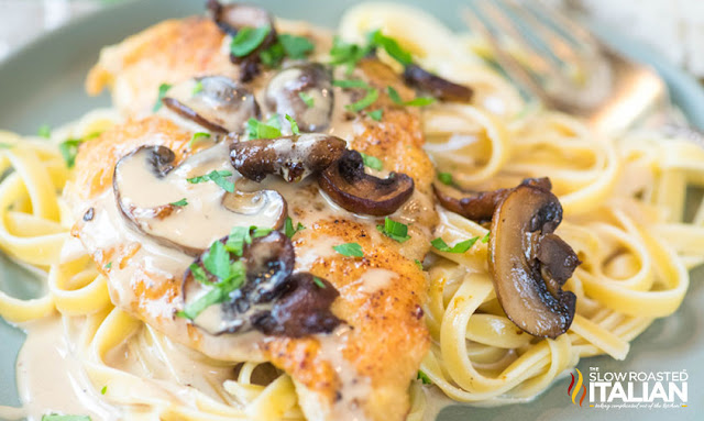 Plate of pasta topped with chicken marsala