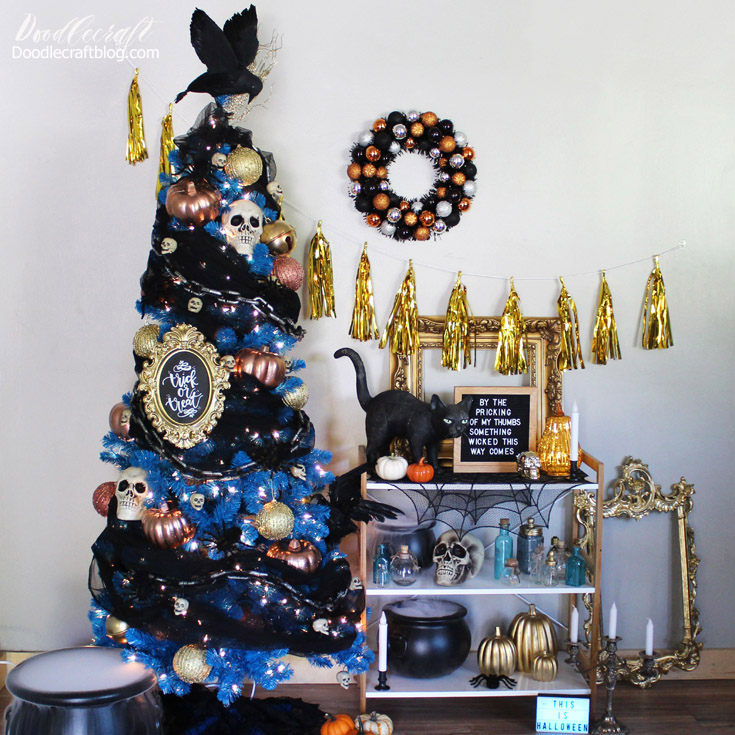 Crows, skulls, spiders, pumpkins and chains adorn this Halloween tree from Treetopia