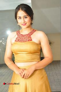 Actress Simrat Juneja Pictures in Golden Long Dress  0029.JPG