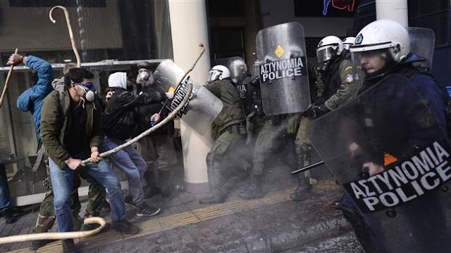 Greek farmers clash with riot police in Athens