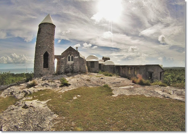 The Idyllic and fairy-tale-esqe, small stone hermitage with tall turret, on the hilltop overlooking the ocean.