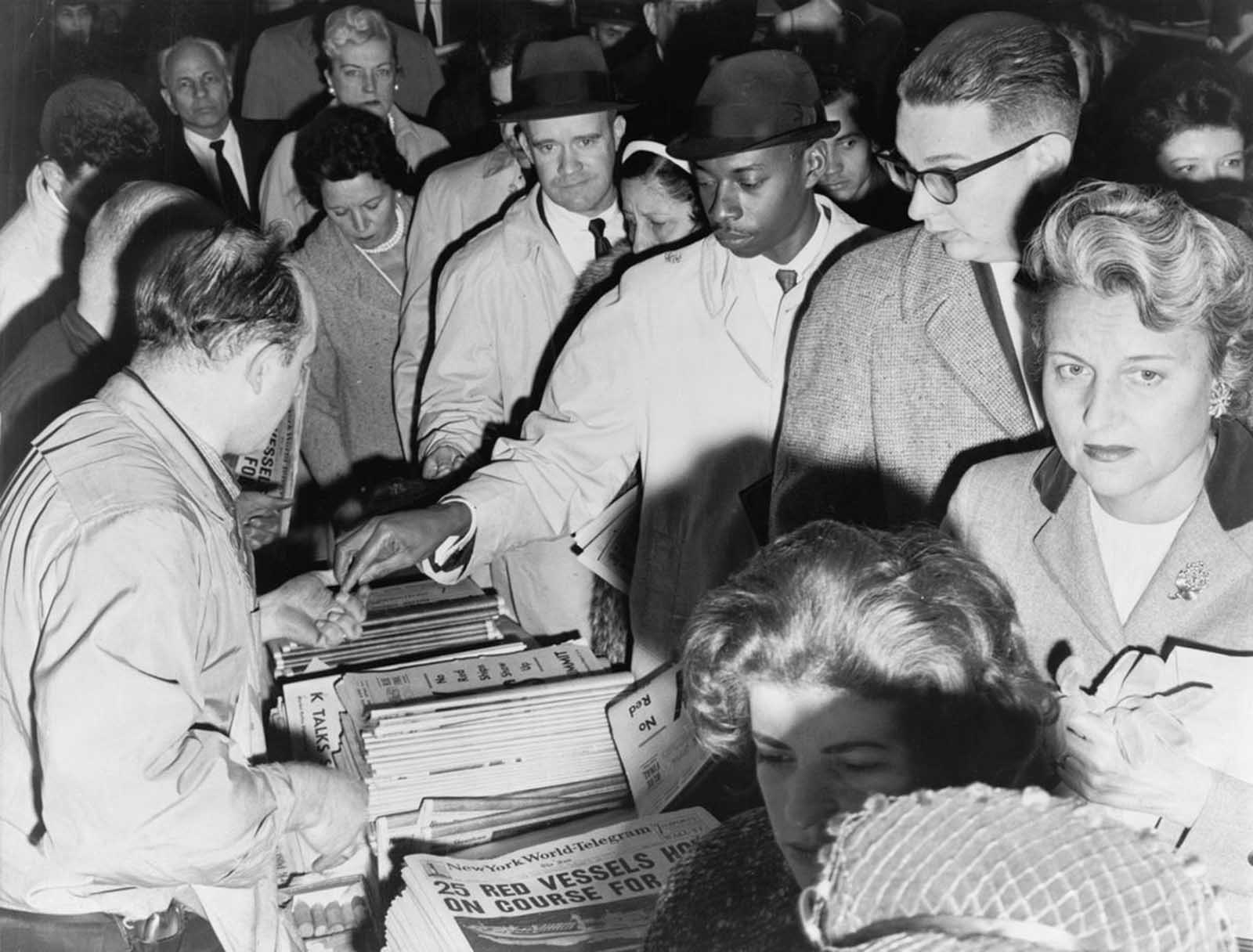 New Yorkers eager for news of the Cuban missile crisis line up to buy newspapers in October of 1962.