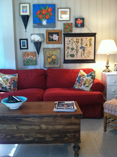 red sofa with gray walls