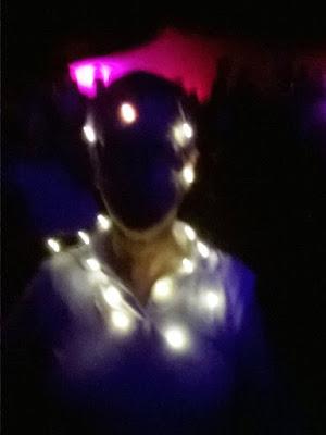 Fairy lights draped around me in the dark