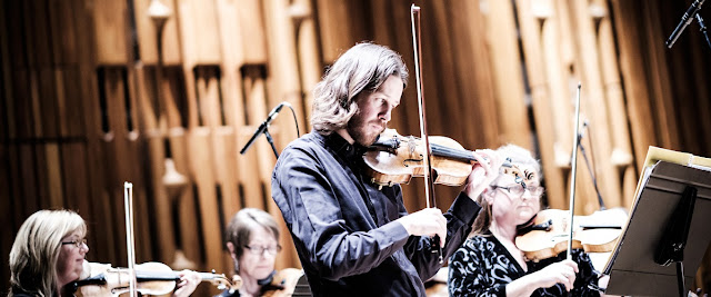 Thomas Gould leads Britten Sinfonia in concert at the Barbican (photo Thomas Skosvende)