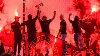 Spartak Moscow fans burn flares during the match at NK Maribor