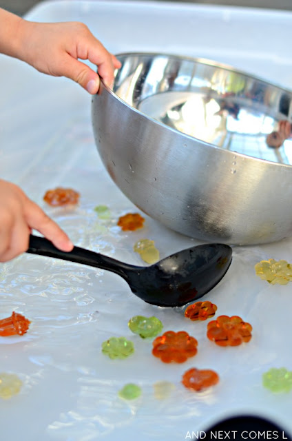 Pumpkin & acorn sensory soup - a simple water sensory activity that encourages fine motor skills from And Next Comes L