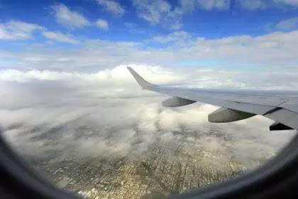 5 Tips Menghilangkan Rasa Bosan di Pesawat
