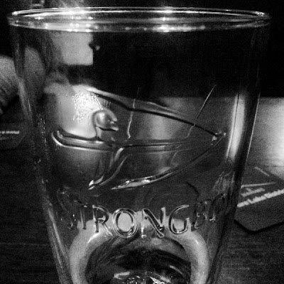Black and white: archer on a pint glass of Strongbow Cider