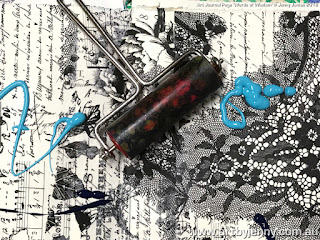 a splash of blue acrylic paint with a brayer on Tim Holtz Collage Tissue Paper