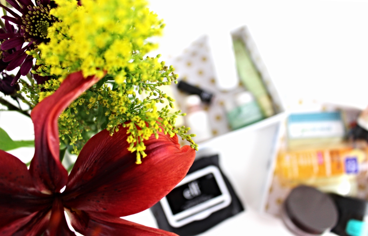 This is a close up of the beautiful bouquet of flowers alongside the winter skin care.