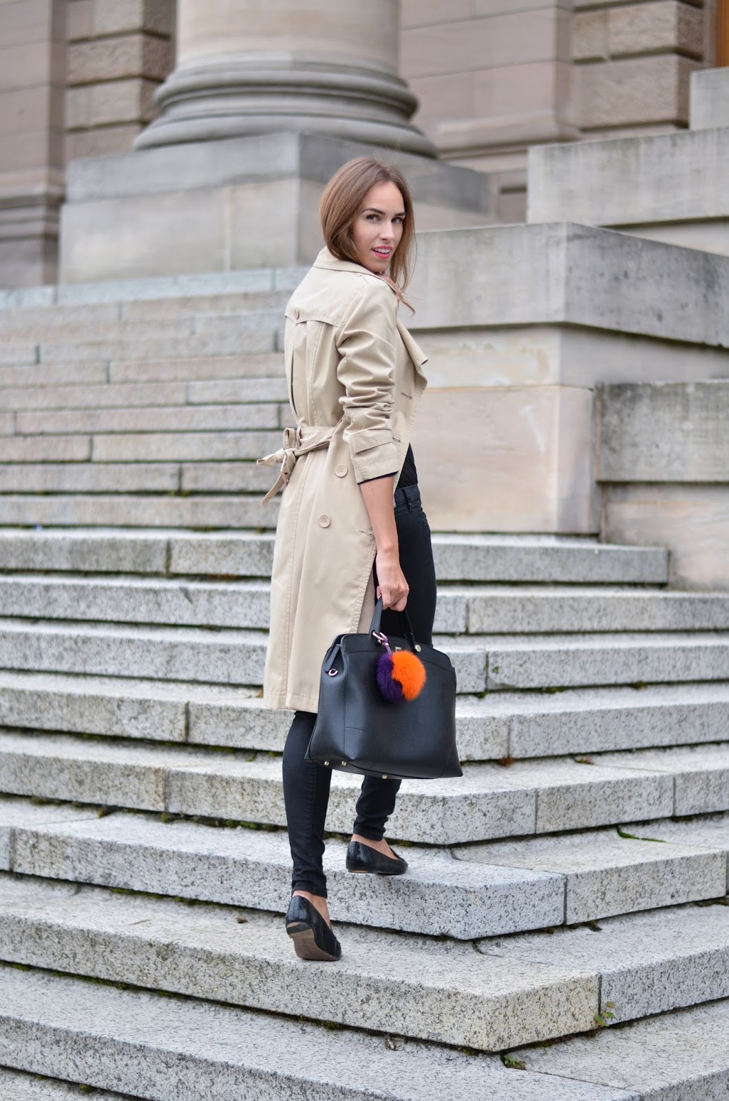 kristjaana mere beige trench coat black jeans outfit
